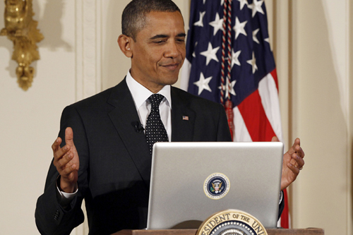 Image: President Barack Obama reacts after his first tweet.